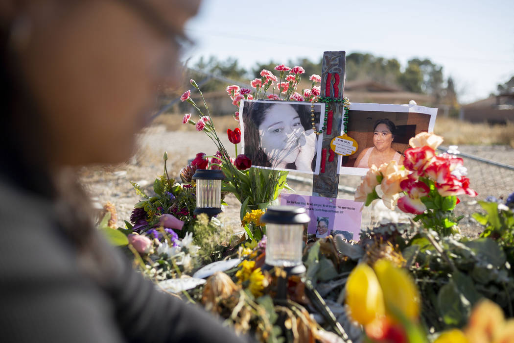 Andrea Lopez puts fresh tulips at the memorial on Monday, Jan. 13, 2020, at the spot where her ...