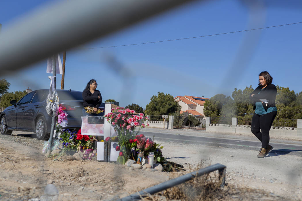 Sisters Andrea Lopez, left, and Ruth Neall look at the memorial on Monday, Jan. 13, 2020, at th ...
