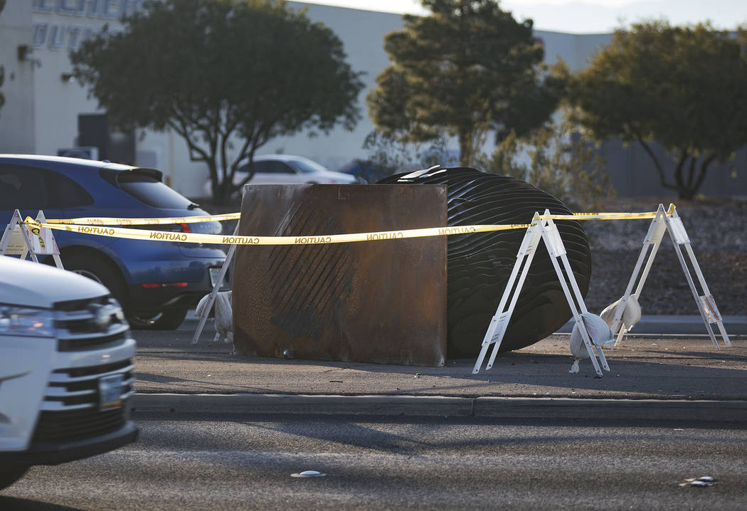 "An SUV crashed into and knocked over one of two ""Norte Y Sur"" steel head sculptures in the medi ..."