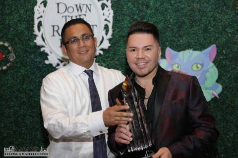 Paco Huerta and Steven Olmos from Silver Lands Inc. accept the Business Partner of the Year awa ...