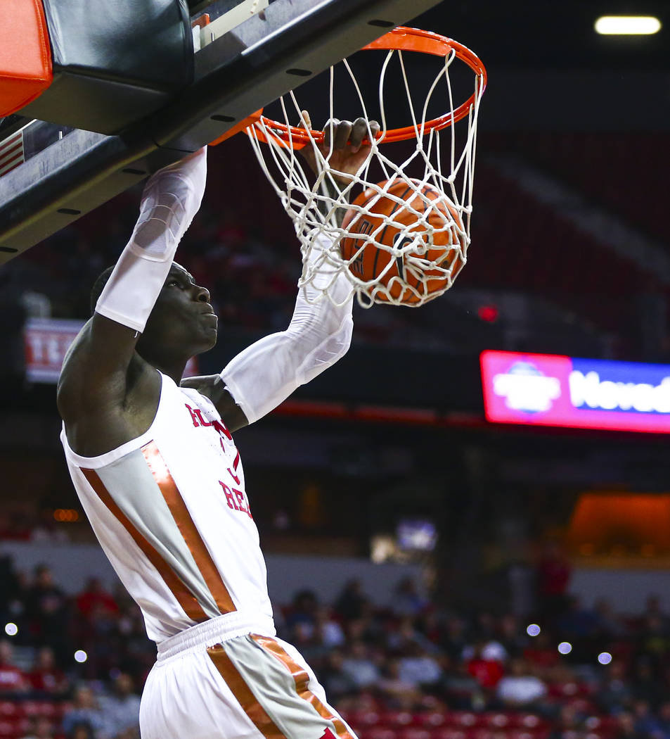 UNLV Rebels' Cheikh Mbacke Diong (34) dunks against San Jose State during the first half of a b ...
