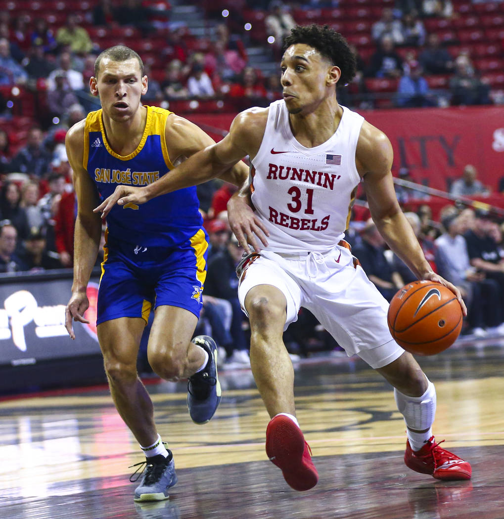 UNLV Rebels' Marvin Coleman (31) drives to the basket against San Jose State Spartans' Brae Ive ...