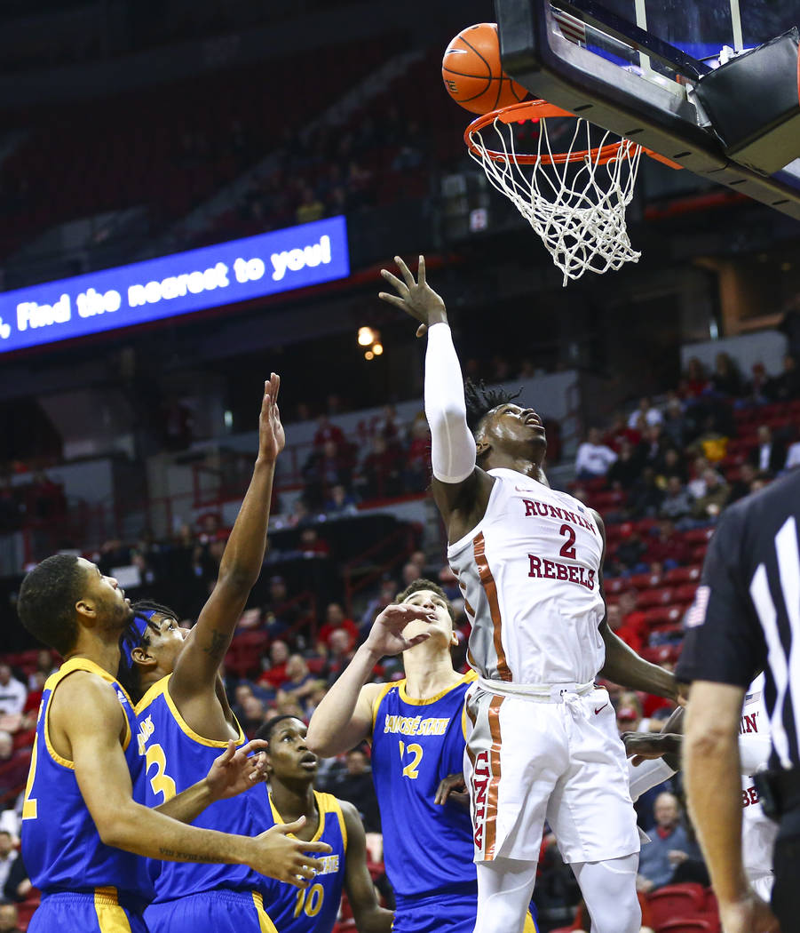 UNLV Rebels' Donnie Tillman (2) goes to the basket past San Jose State defenders during the sec ...