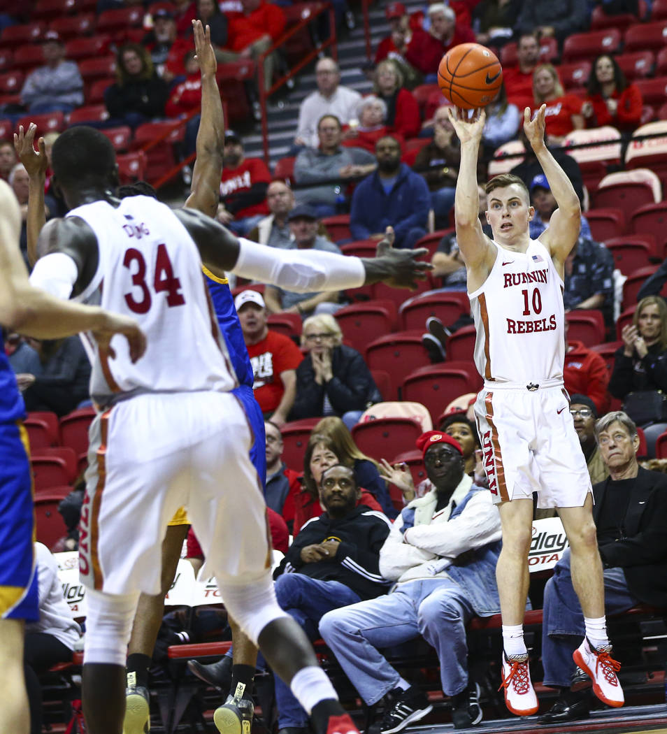 UNLV Rebels' Jonah Antonio (10) shoots to score a three-pointer against San Jose State during t ...