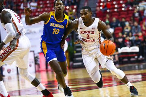 UNLV Rebels' Amauri Hardy (3) drives the ball past San Jose State Spartans' Omari Moore (10) du ...