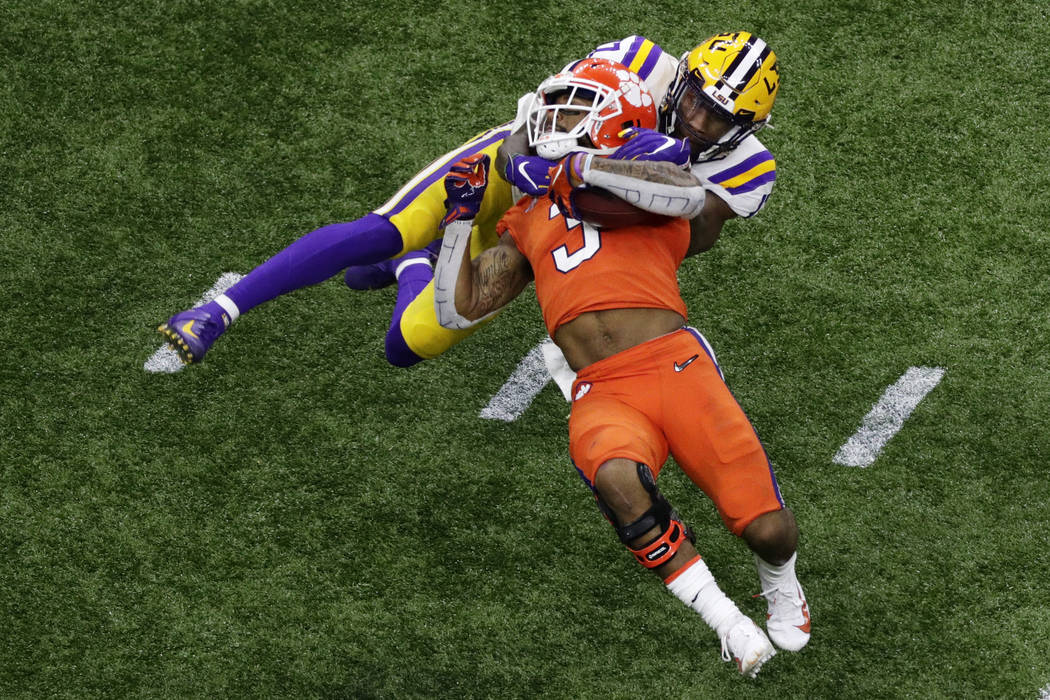 Clemson wide receiver Amari Rodgers is tackled by LSU's Racey McMath during the second half of ...