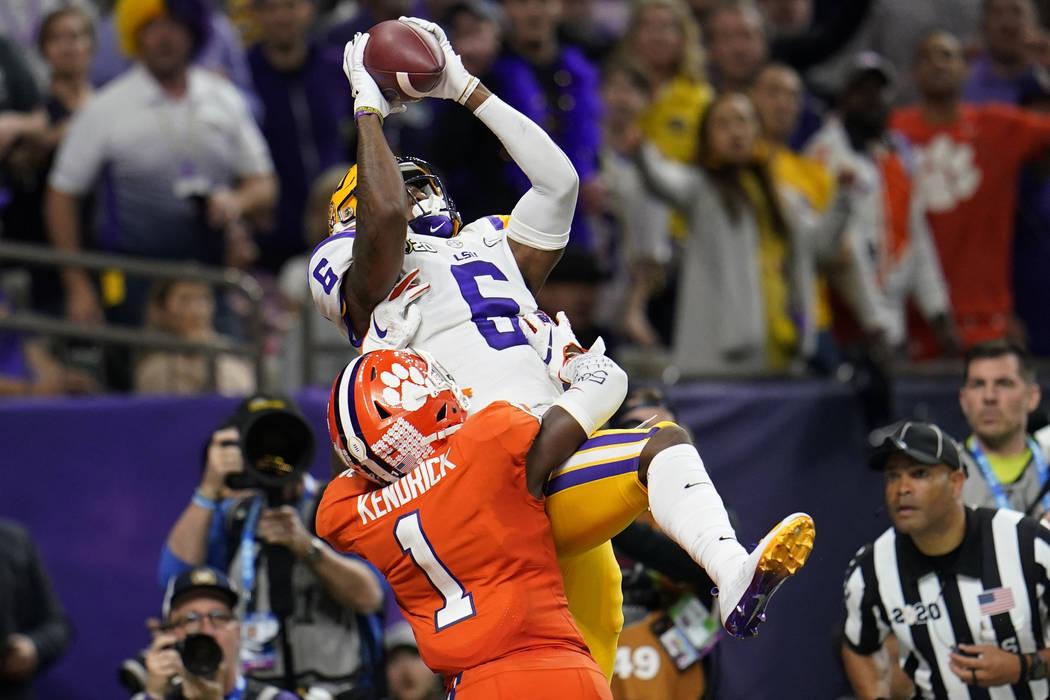 LSU wide receiver Terrace Marshall Jr. catches a touchdown pass over Clemson cornerback Derion ...