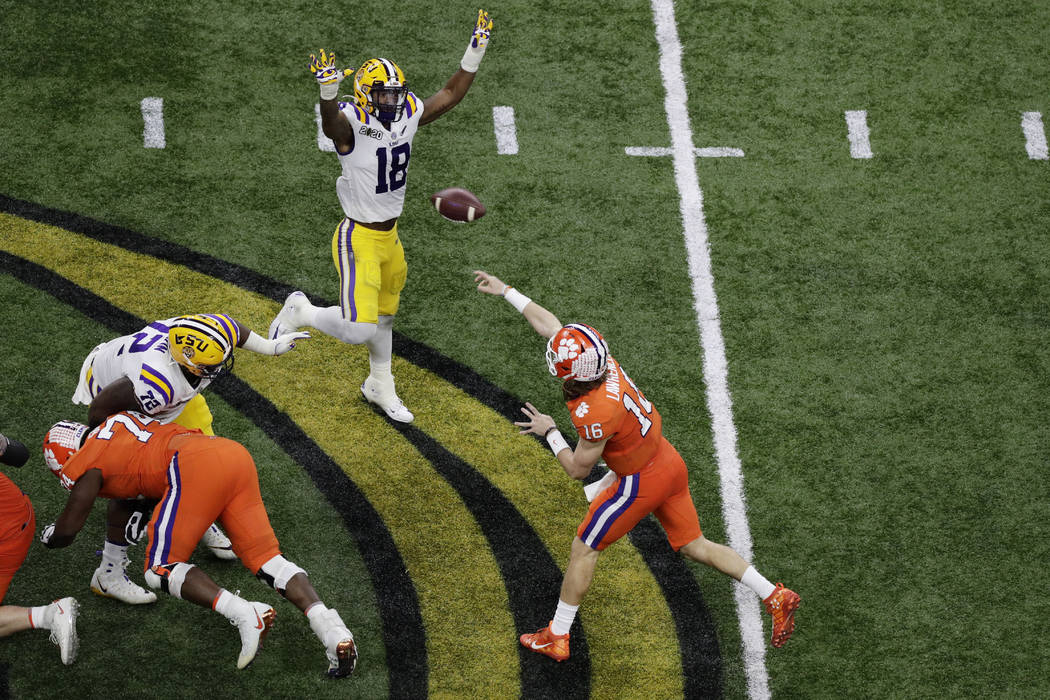 Clemson quarterback Trevor Lawrence passes against LSU during the second half of a NCAA College ...