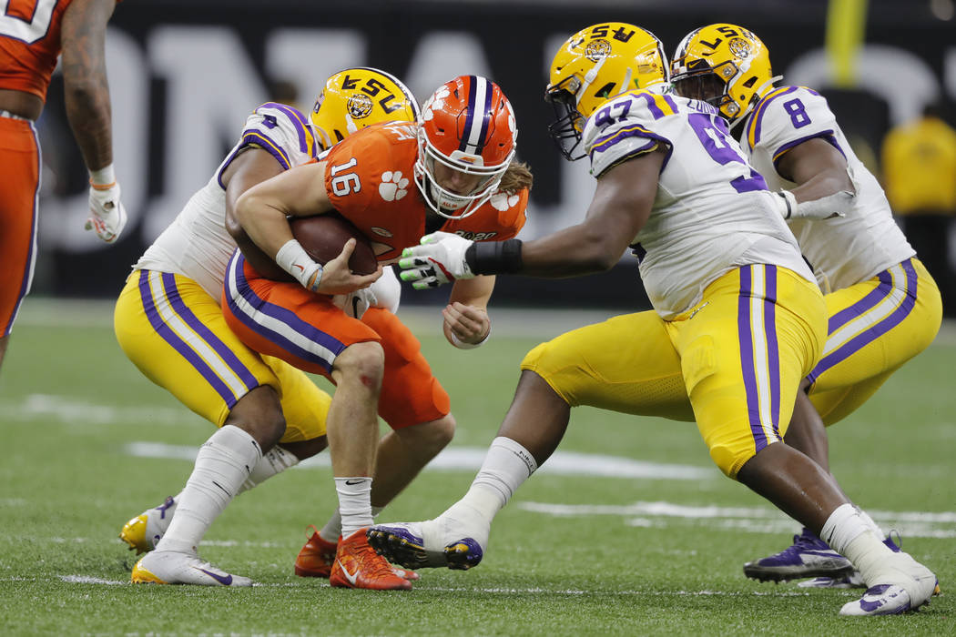 Clemson quarterback Trevor Lawrence gets sacked by LSU during the second half of a NCAA College ...