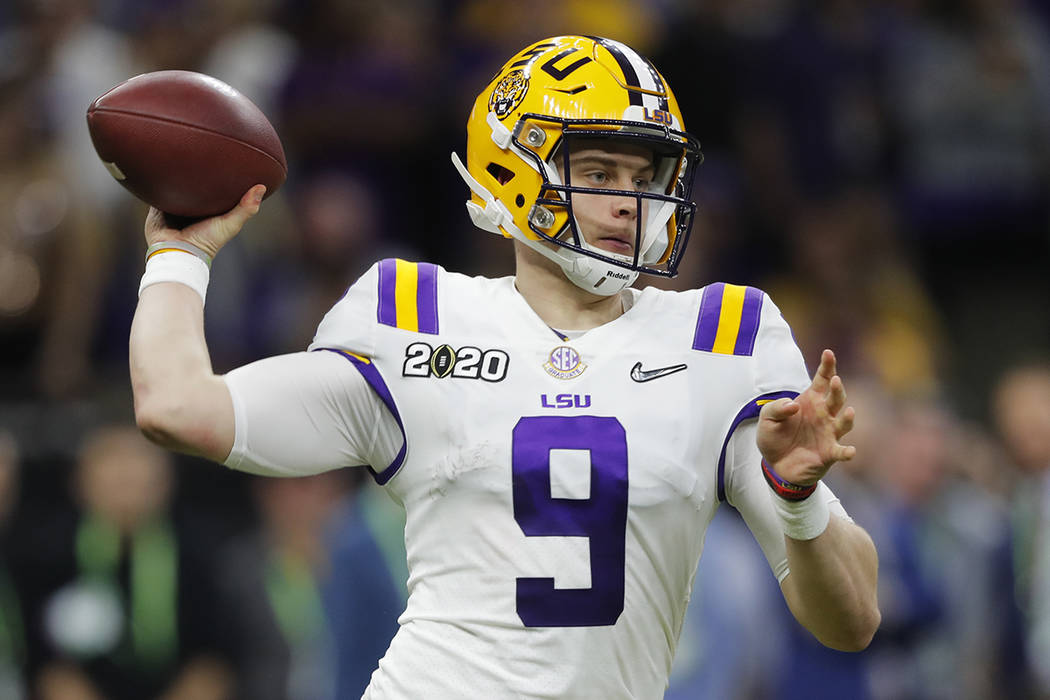 LSU quarterback Joe Burrow threw for more than 400 yards and five touchdowns against Clemson to ...