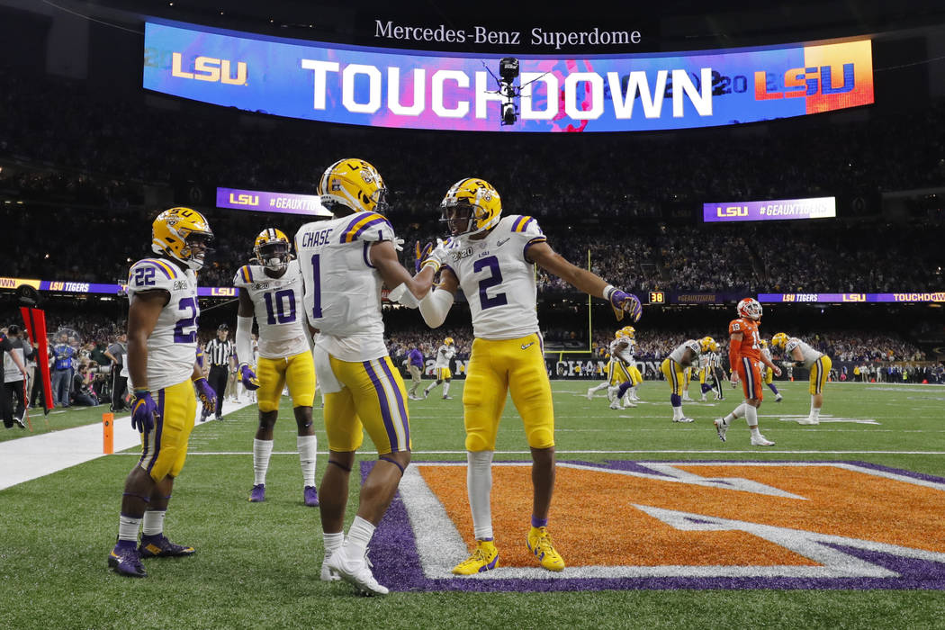 LSU wide receiver Ja'Marr Chase (1) celebrates after scoring with wide receiver Justin Jefferso ...