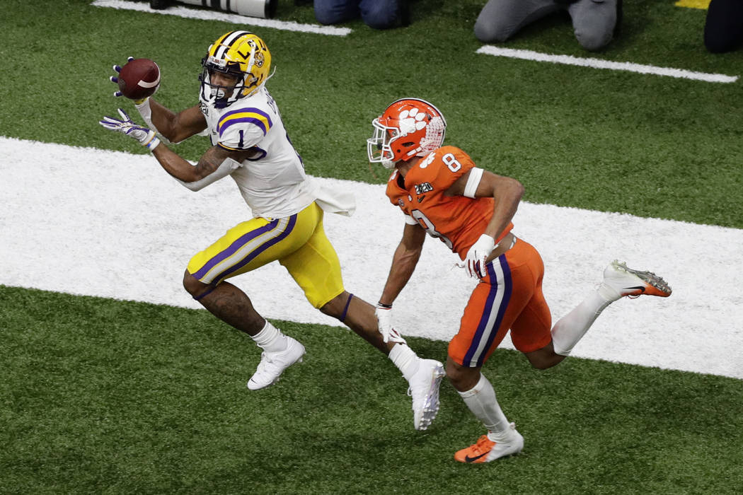 LSU wide receiver Ja'Marr Chase catches a touchdown pass in front of Clemson cornerback A.J. Te ...