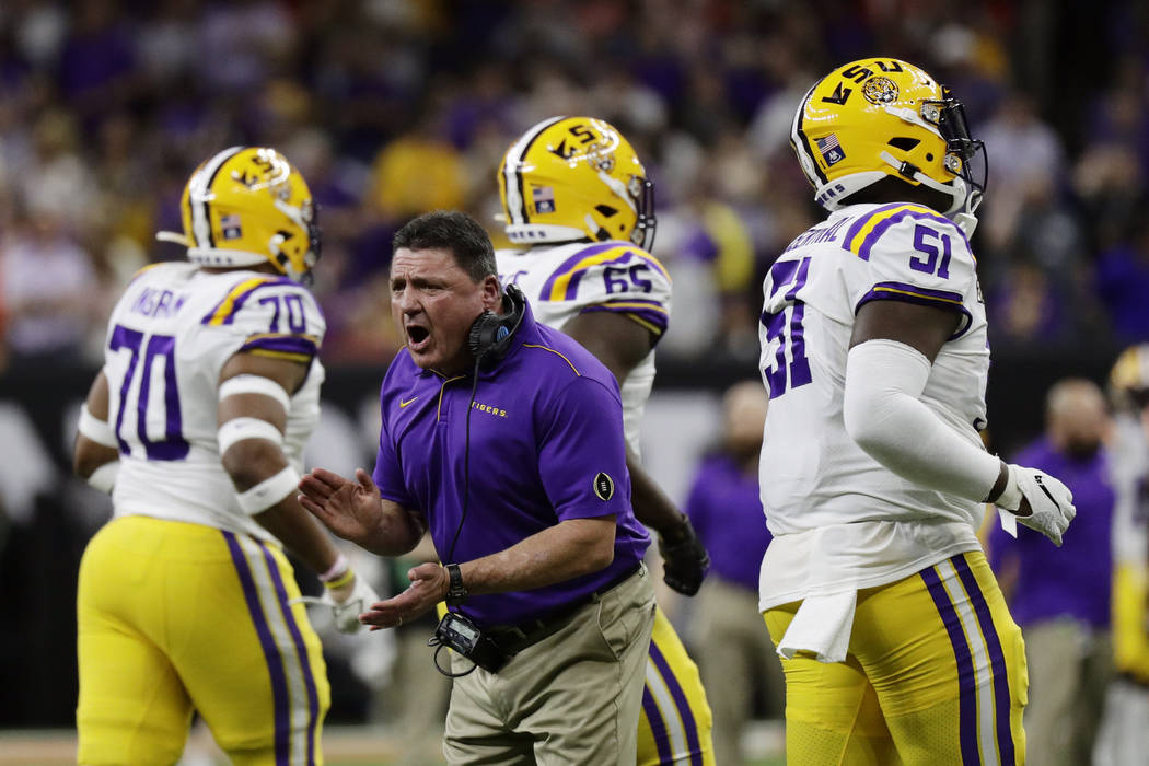 LSU head coach Ed Orgeron cheers during the first half of a NCAA College Football Playoff natio ...