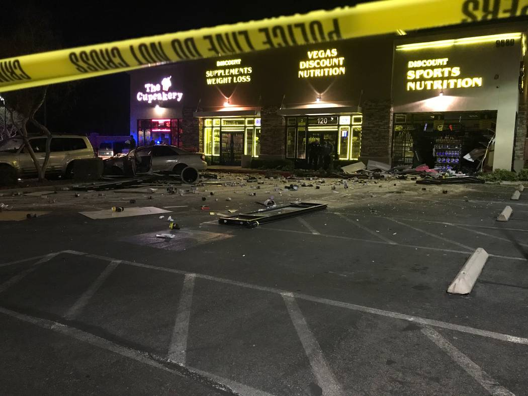 A car on Monday, Jan. 13, 2020, crashed through the Vegas Discount Nutrition store at Eastern a ...