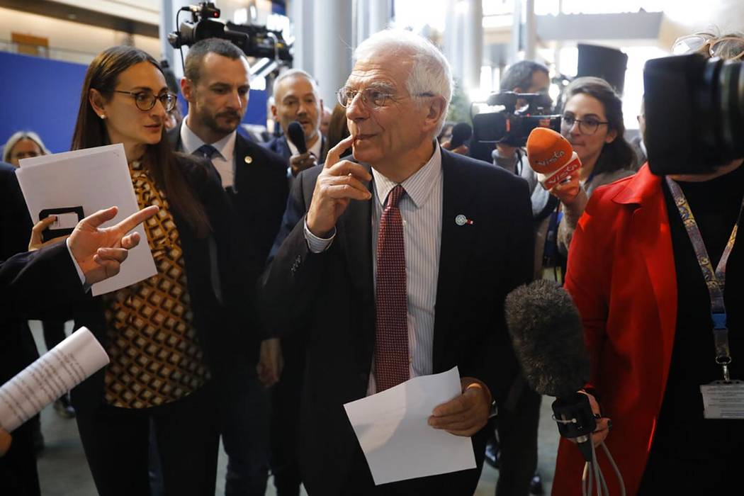 European Union foreign policy chief Josep Borrell is surrounded by reporters at the European pa ...