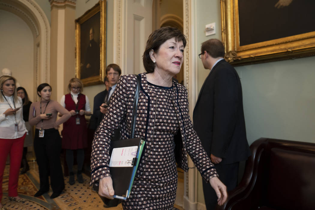 Sen. Susan Collins, R-Maine, arrives for a closed meeting with fellow Republicans about the loo ...