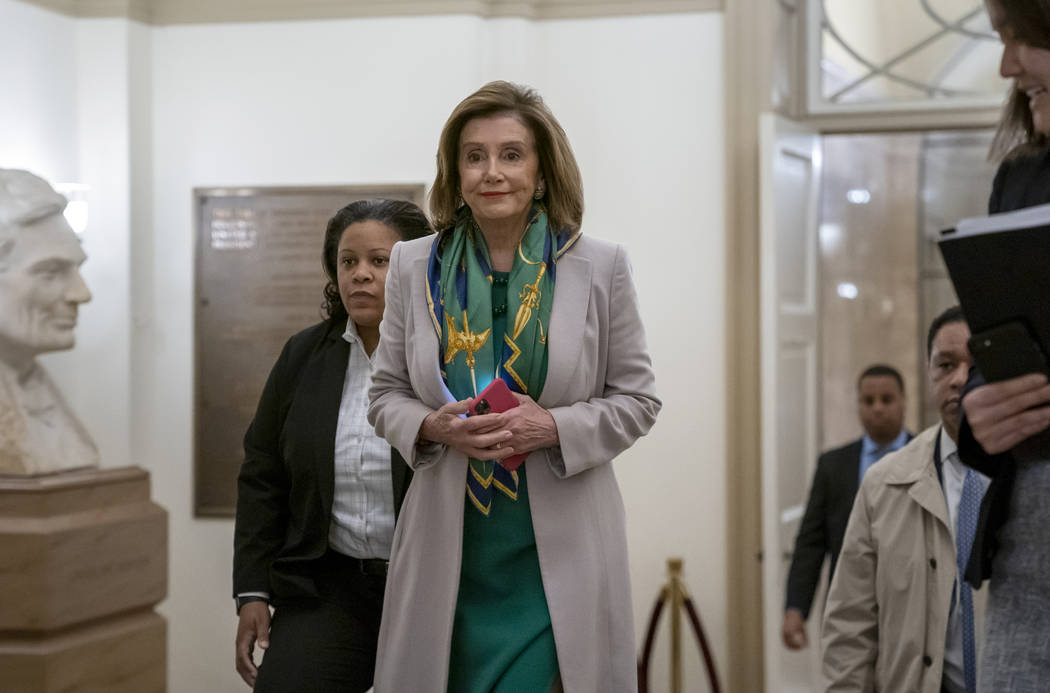 Speaker of the House Nancy Pelosi, D-Calif., arrives to meet with the Democratic Caucus at the ...