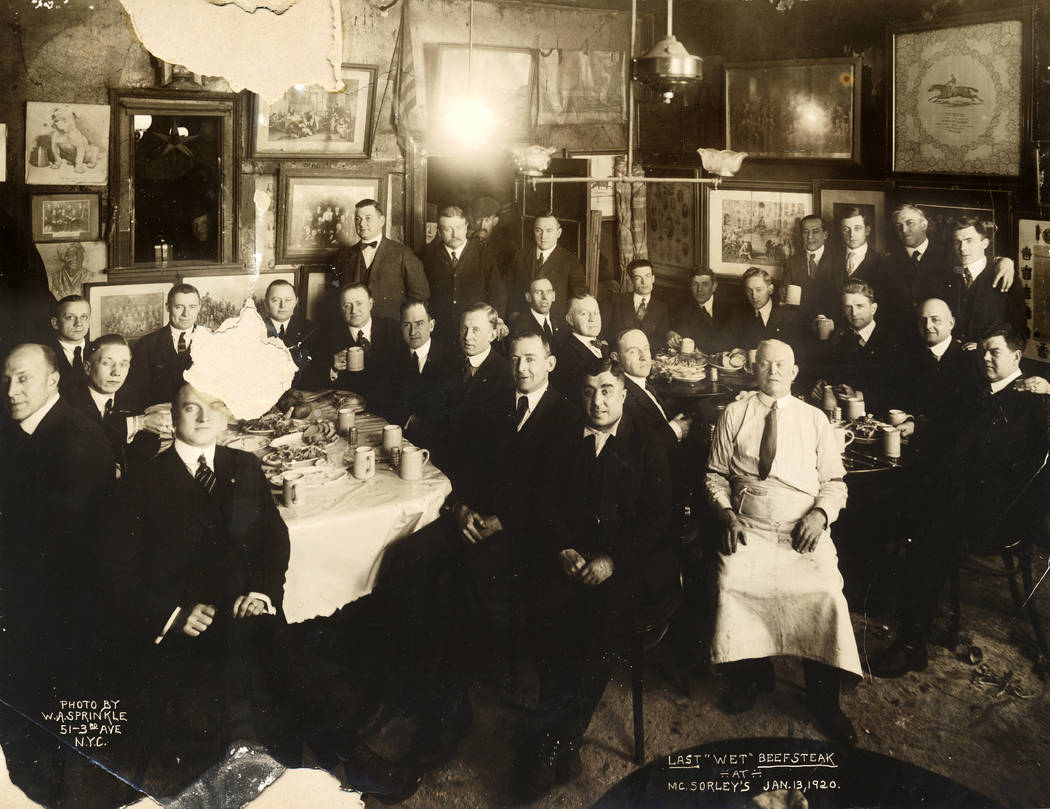 In this Jan. 13, 1920 photo provided by McSorley's Old Ale House, clients and staff pose in the ...