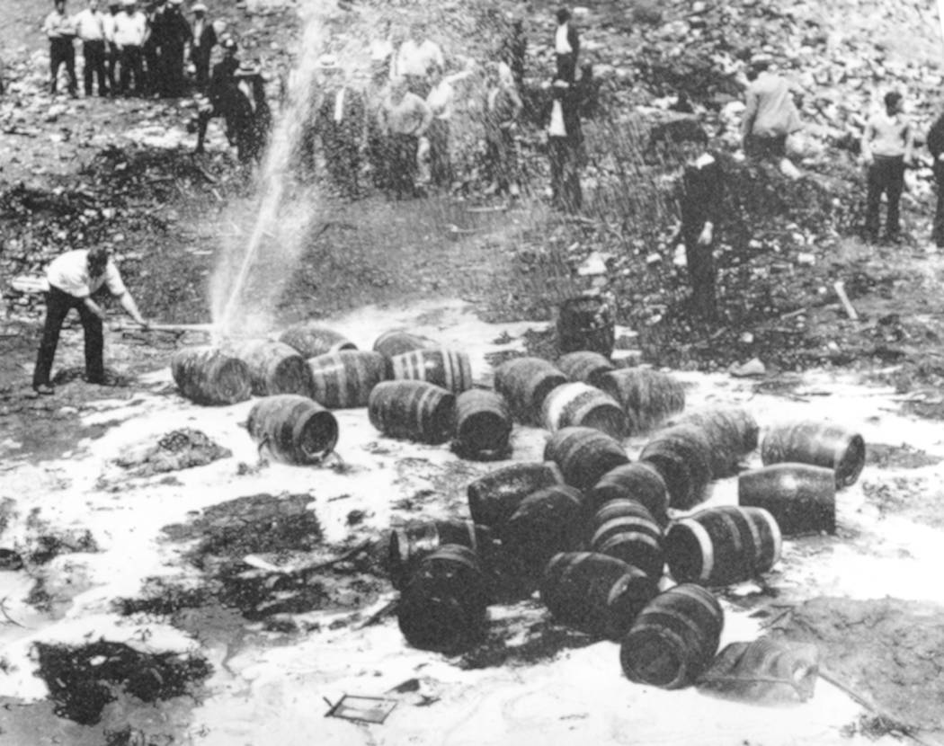 FILE - In this June 18, 1931, file photo beer barrels are destroyed by prohibition agents at a ...