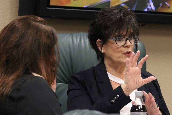 Nevada State Board of Dental Examiners executive director, Debra Shaffer-Kugel, right, speaks a ...