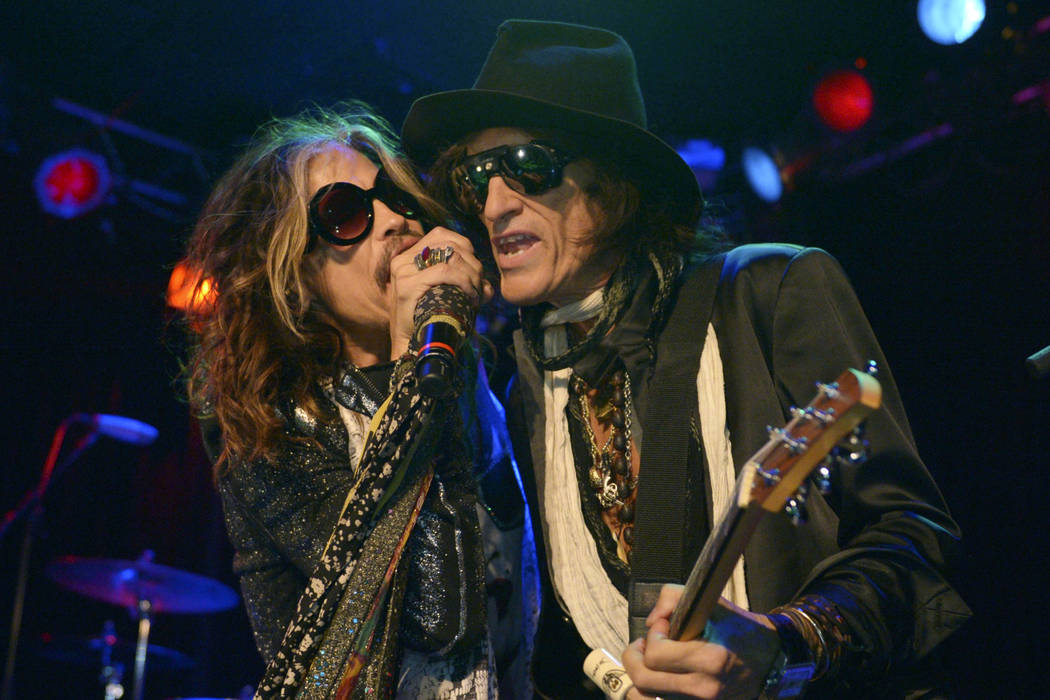 FILE - In this April 8, 2014 file photo, Steven Tyler, left, and Joe Perry of Aerosmith perform ...