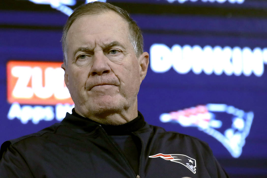 New England Patriots head coach Bill Belichick speaks to the media following an NFL football ga ...