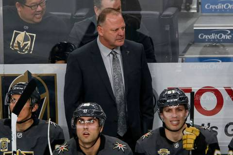 Vegas Golden Knights head coach Gerard Gallant watches his team as play continues during the fi ...