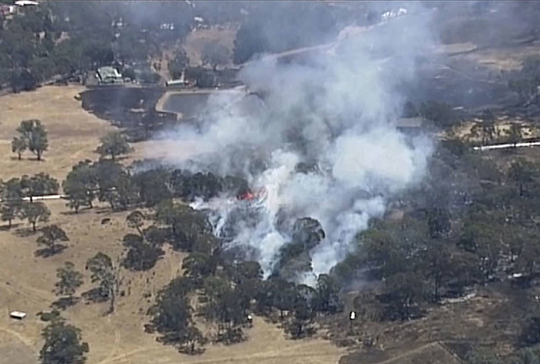 In this image made from video, an aerial scene shows wildfires burning in the Adelaide Hills, A ...