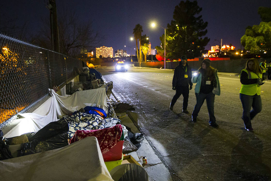 Volunteers find homeless people along Veterans Memorial Drive in downtown Las Vegas during the ...