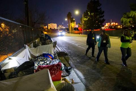 Volunteers find homeless people along Veterans Memorial Drive in downtown Las Vegas during the ...