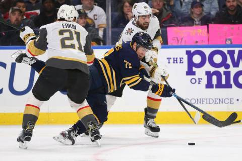 Buffalo Sabres forward Evan Rodrigues (71) is taken down by Vegas Golden Knights forward Cody E ...