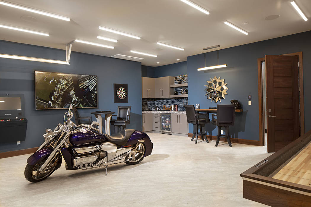 One of the two garages can be used as a man cave. (Jeffrey A. Davis Photography Inc.)
