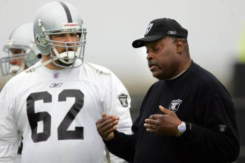 Oakland Raiders coach Art Shell, right, instructs offensive lineman Adam Treu (62) during footb ...