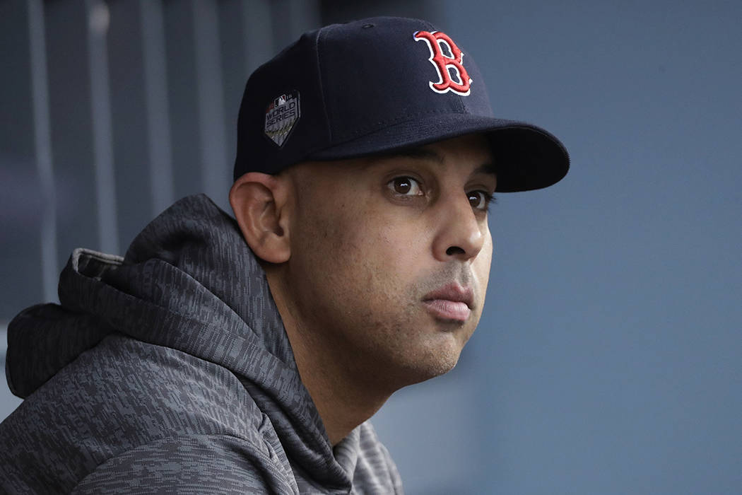 FILE - In this Oct. 28, 2018, file photo, Boston Red Sox manager Alex Cora waits for the start ...