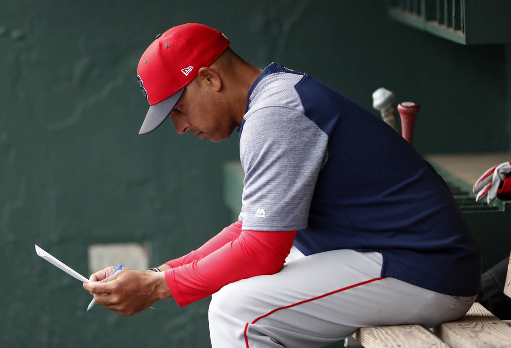 FILE - In this March 20, 2019, file photo, Boston Red Sox manager Alex Cora looks over the line ...