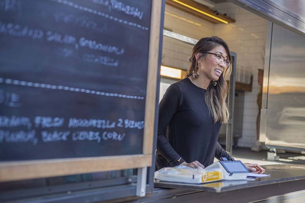 Rachelle Luna takes orders from the Custom Pizza Truck, parked on 317 S. Sixth St., in Las Vega ...