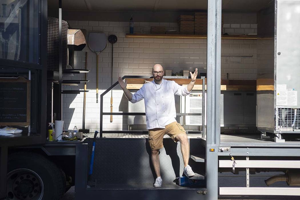 Chef Bartosz Wawrzyszak, owner of the Custom Pizza Truck, stands in his food truck parked on 31 ...