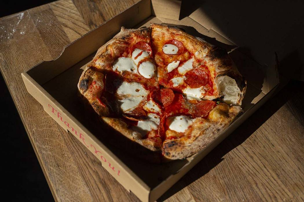 A Salami Gorgonzola pizza that cooked in 90 seconds, is ready to be served from Custom Pizza Tr ...