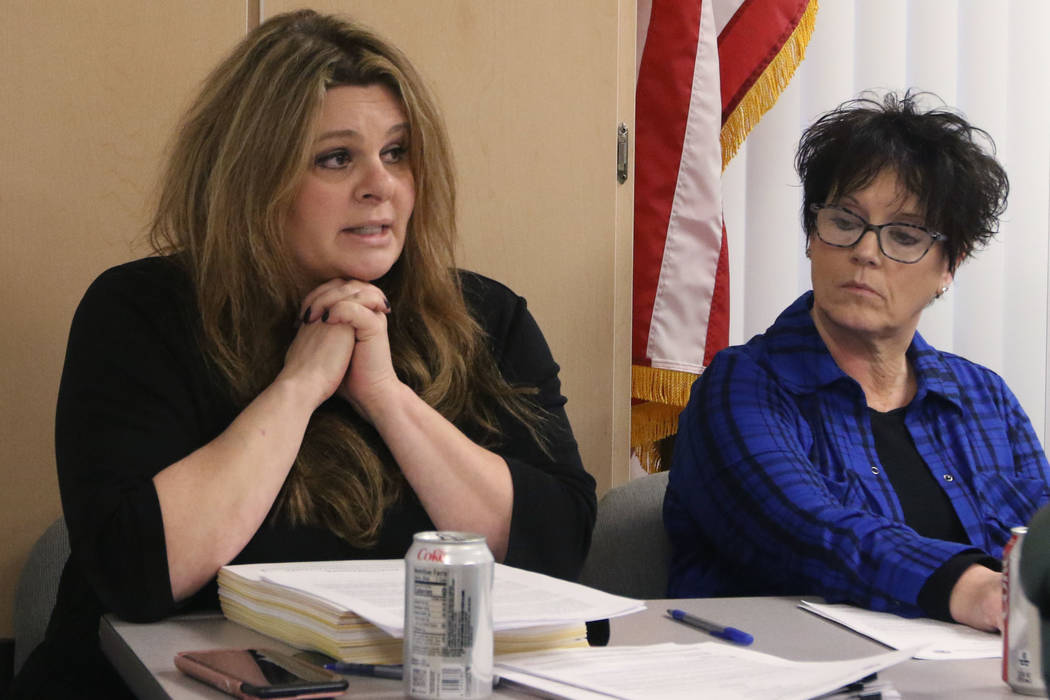 Debra Shaffer-Kugel, right, executive director of the Nevada Board of Dental Examiners, listens ...