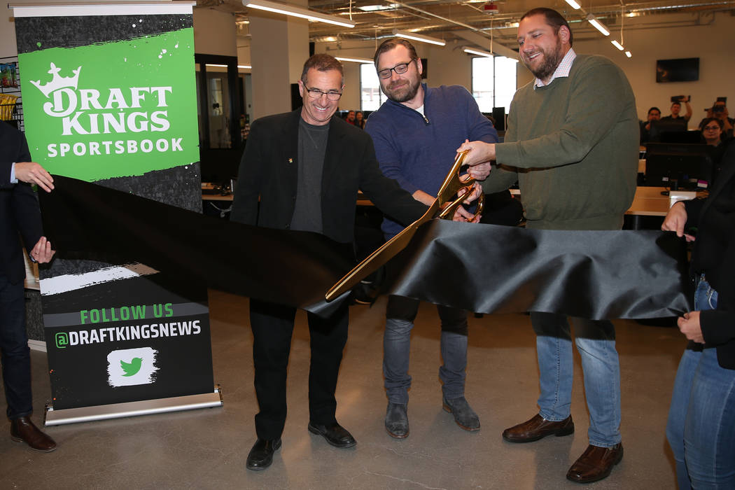 DraftKings' Johnny Avello, from left, director of race and sports books operations, Matt Kalish ...