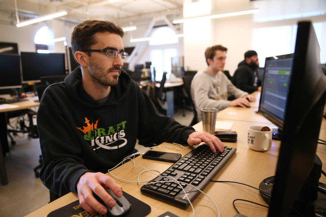 Will Pagliaro, costumer experience team leader for DraftKings, works inside the new DraftKings ...