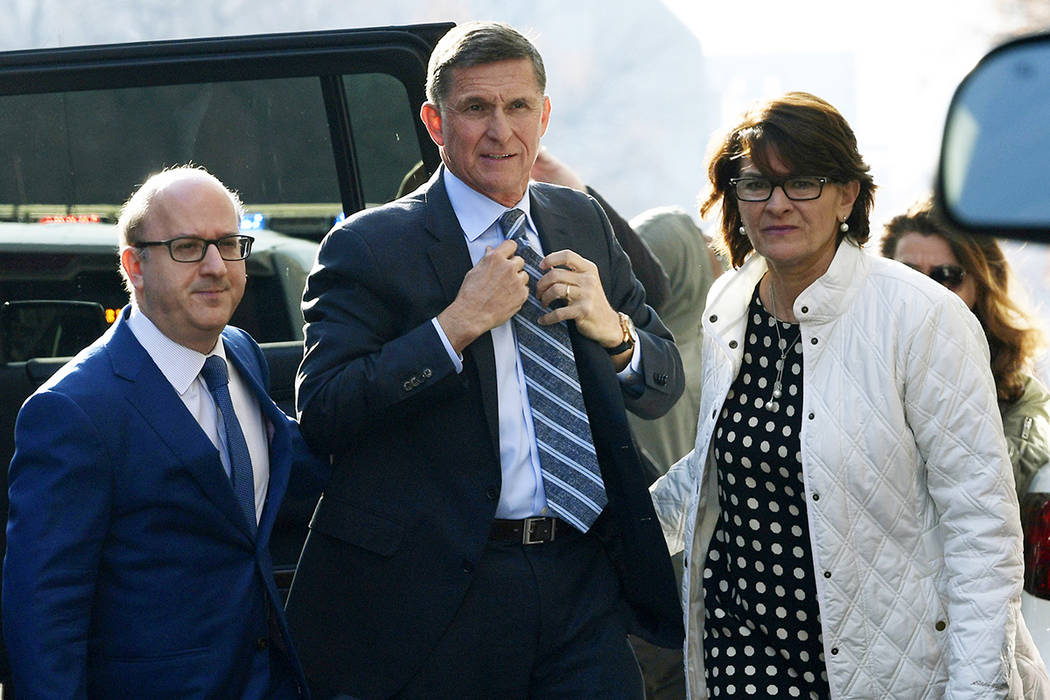 FILE - In this Dec. 1, 2017, file photo, Michael Flynn, center, arrives at federal court in Was ...