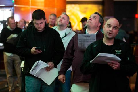 Bettors wait in line at the Westgate sportsbook on Thursday, Jan. 23, 2020, in Las Vegas. (Benj ...