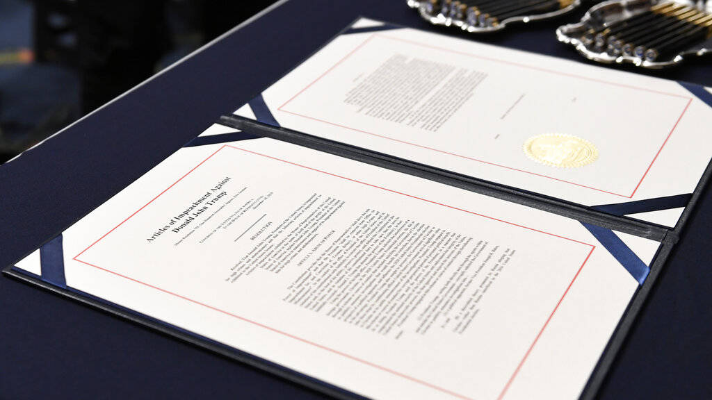 The articles of impeachment against President Donald Trump on the desk before House Speaker Nan ...
