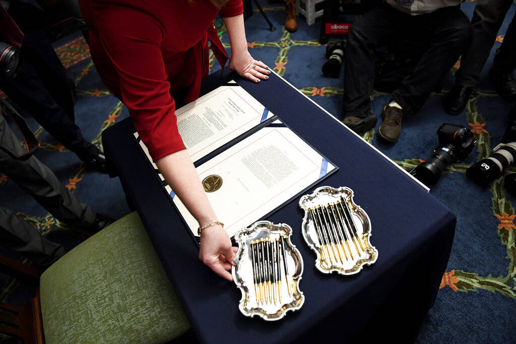 UNITED STATES - JANUARY 15: A clerk places a tray of pens before Speaker of the House Nancy Pel ...
