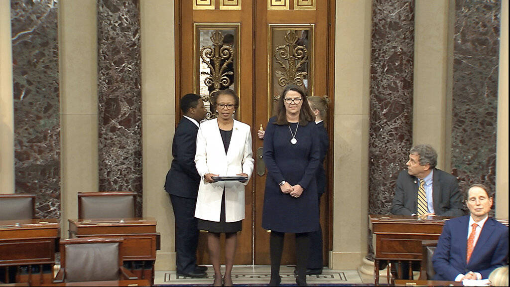 In this image from video, Clerk of the House Cheryl Johnson, left, delivers articles of impeach ...