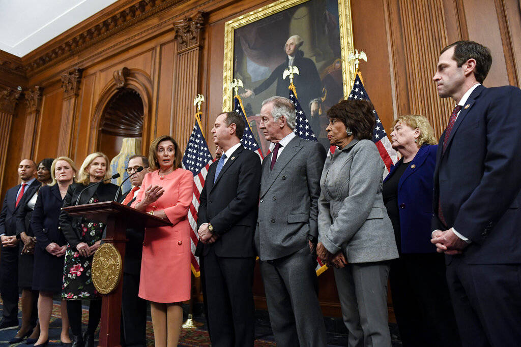 Speaker of the House Nancy Pelosi, D-Calif., speaks during an engrossment ceremony to sign the ...