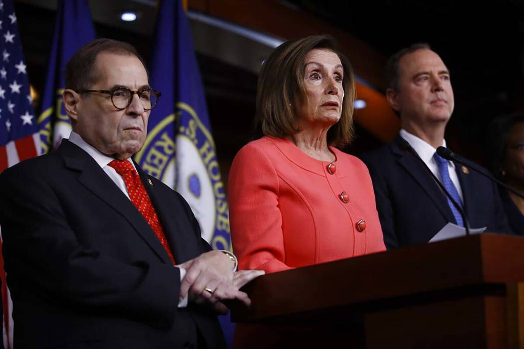 House Speaker Nancy Pelosi of Calif., speaks during a news conference to announce impeachment m ...