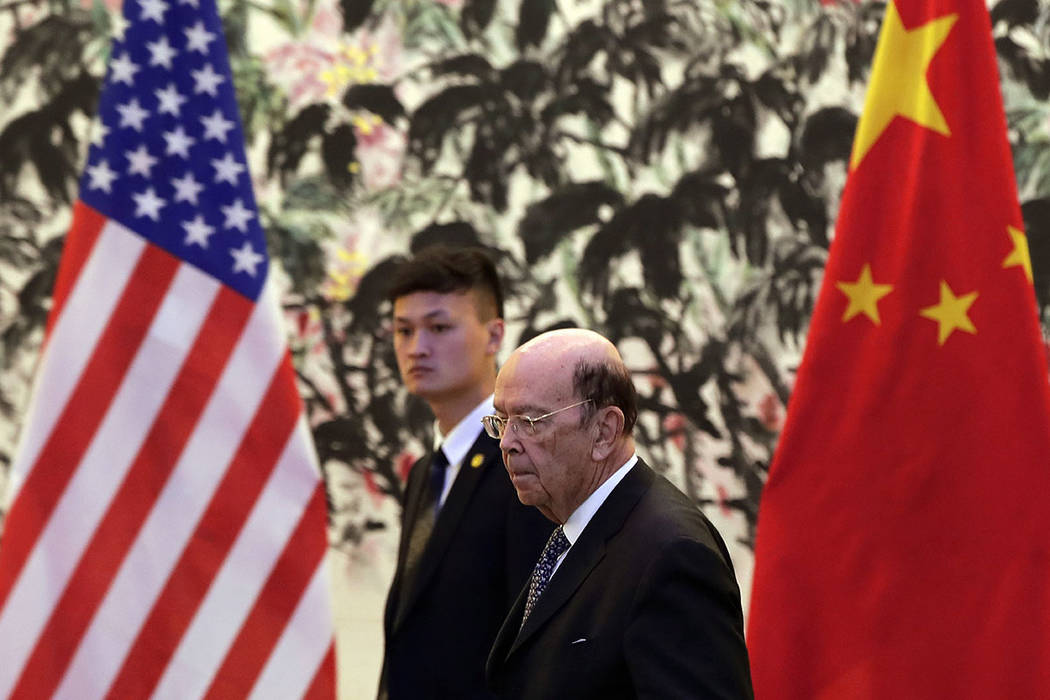 U.S. Commerce Secretary Wilbur Ross arrives to the Diaoyutai State Guesthouse to attend a meeti ...