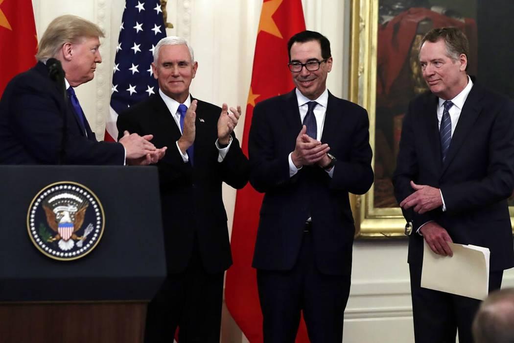 President Donald Trump acknowledges Vice President Mike Pence, Treasury Secretary Steven Mnuchi ...